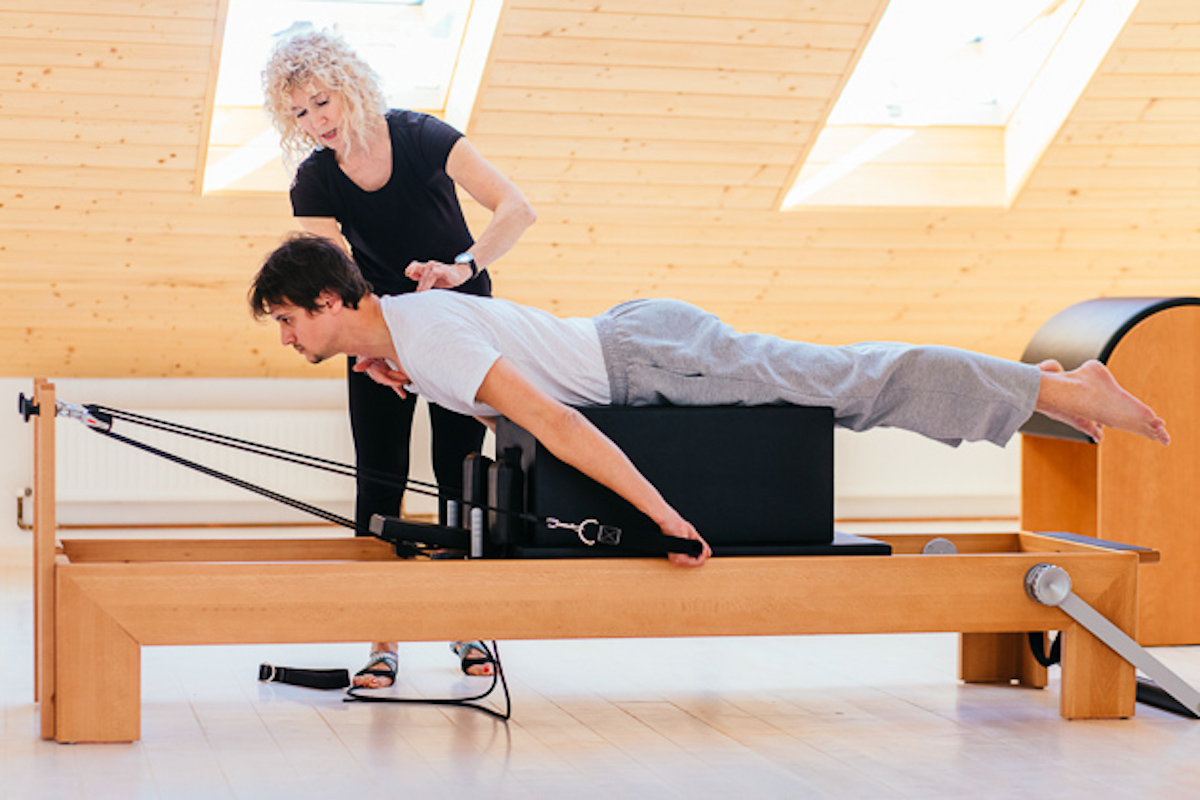 Pilates instructor, Pilates instructor with client