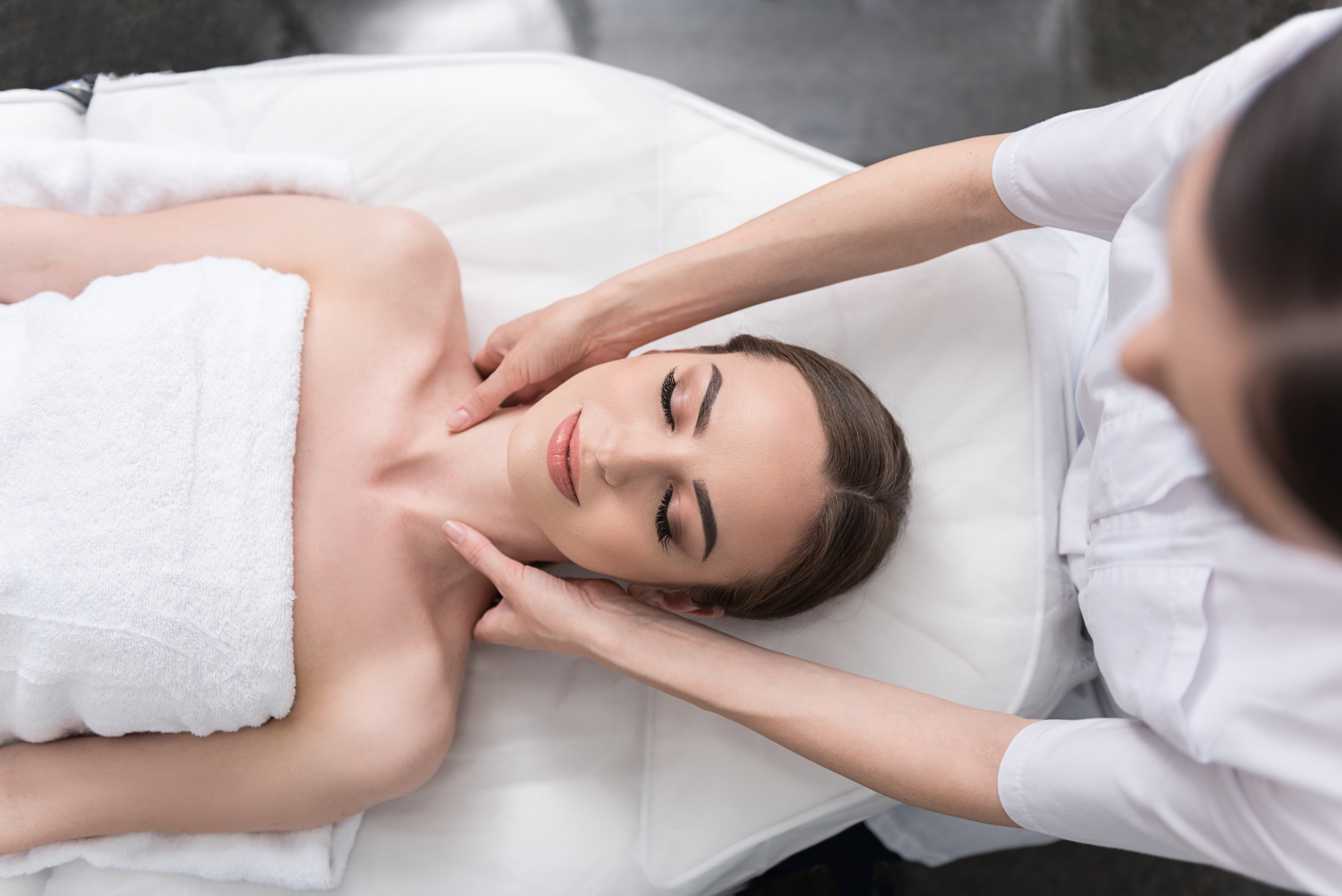 how to attract more clients to your wellness center, woman enjoying massage
