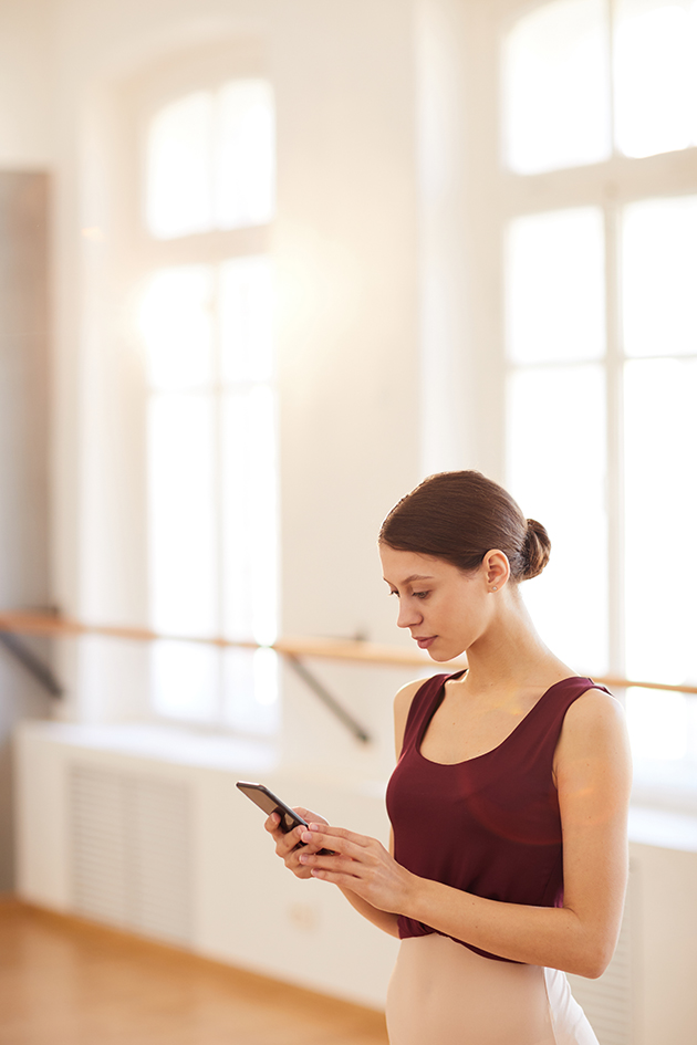 dance school manager software, dancer with phone